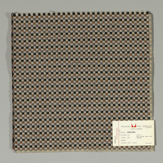 Pattern of small checks in black, grey, brown and white. Warp threads are white and weft threads are black with supplementary weft in brown and grey.