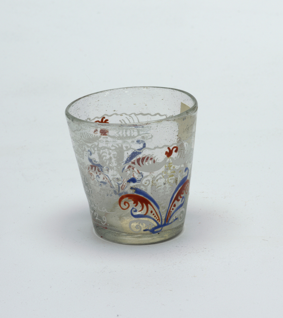 "Clear glass beaker with slight blue cast on glass.  Painted decoration with bird and ""1729"" as central figures."