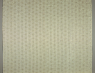 White panel with jacquard pattern of even rows of small circles.