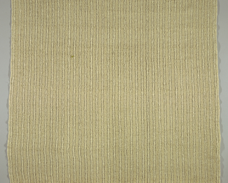 Panel of casement cloth of natural color rough textured yarns; the heavier yarns of the warp create a pattern of vertical stripes.