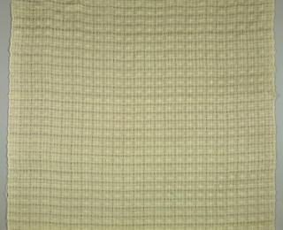 Panel of natural wool casement with small repeat pattern of openwork squares.