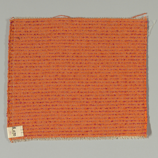 Plain weave in orange with horizontal magenta stripes. Warp is comprised of thin light brown threads. Weft is comprised of orange and magenta boucle yarn.