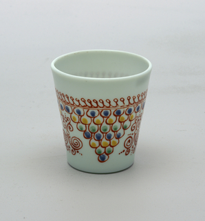 Opaque white glass with slight blue cast.  Painted decoartion with an inverted pyramid pattern (3) around body.