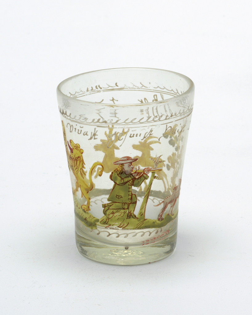 Clear glass beaker with painted decoration.  Hunter on a hunt central decoration.