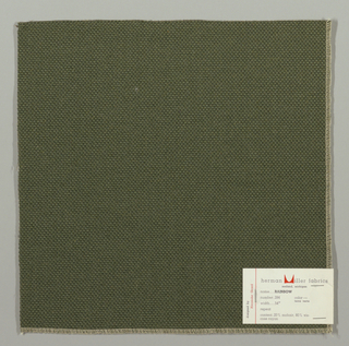 Plain weave with doubled warps and wefts in dark green. Weave structure adds a subtle surface texture. Number 284.
