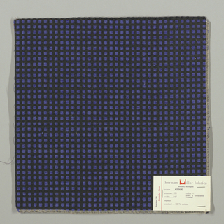Warp-faced plain weave in black with small blue squares. Blue squares are formed by supplementary weft floats.