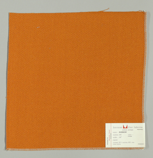 Plain weave with doubled warps and wefts in orange. Weave structure adds a subtle surface texture. Number 282.