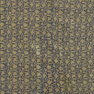 Repeats of a floral design in tan on blue background. Border with flowers and animals in multicolored silk. Lined in red wool.