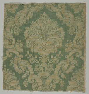 Floral forms in leaf scroll in green, yellow and beige.