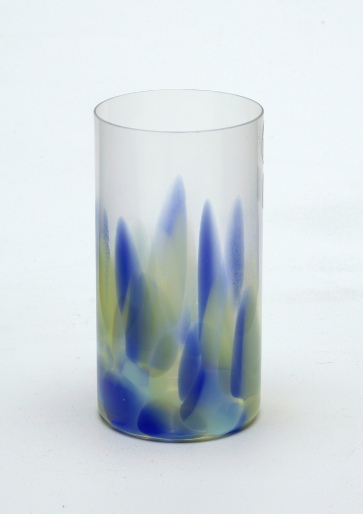 Thin-walled cylindrical tumbler of clear, blue, aqua and yellow glass, the lower two thrids with vertical brushstroke-like decoration.