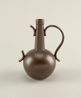 "Matte dark brown vase: globular body with tall, tapering cylindrical neck and circular mouth; large, S-curve loop handle on one side, short curving projections on opposite side, suggesting ""missing"" loop handle."