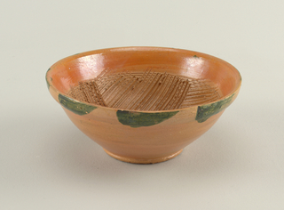Conical bowls with thickened rims.  A) painted with green radiating strokes; B) Painted with green loop and dots; C) Painted with green blotches on outside rim; inside of bowl incised with diagonal lines in alternating direction.