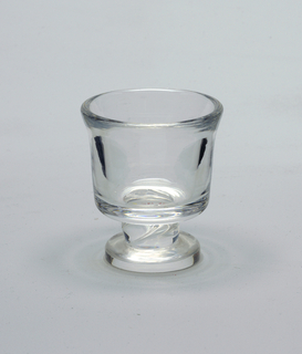 "Clear glass, squared shaped vessel with  short foot; Signed by ""Steuben"""