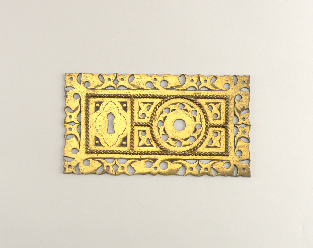 Rectangular brass lock with pierced Gothic design of stylized foliage and brass 'rope' applique.