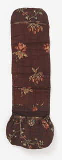 Rectangular piece with a pocket at one end and a pouch at the other, made from many small pieces of at least four different 18th century block-printed floral cottons on brown grounds.