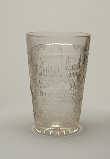 Clear tapering cylindrical form with pressed decoration of rocail scrollwork surrounding four scenes from the 1904  Louisiana Purchase Exposition: the Palace of Machinery, the Cascade Gardens, the Louisiana Purchase Monument and St. Louis Union Station.  Radiating star on underside of base.
