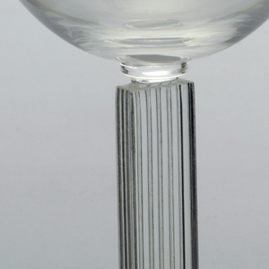 Wide champagne glass with stem resembling fluted column with wide foot.
