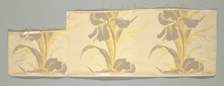 Narrow sample of a horizontally ribbed ground with a single row of three iris flowers and feathery ferns in satin weave.