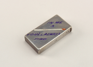 "Rectangular, the front inscribed on the diagonal with the word/picture rebus ""In Me A [Match] You'll Always Find,"" the text in blue enamel, an image of the match featured in white with red tip. Reverse undecorated. Lid hinged on left. Striker on bottom."
