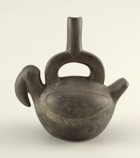 Bird-shaped vessel with stirrup spout; horizontal ovoid body with applied wings, square tail and head of toucan.  Square-section stirrup with rounded spout (chipped).