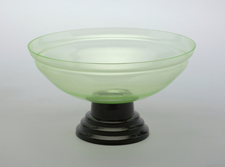 Green bowl with black stand.