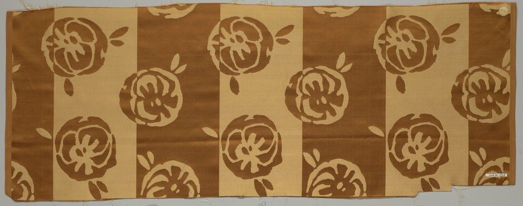 Sample of satin fabric with broad vertical stripes alternately satin and vertically ribbed cloth. Staggered horizontal repeat of highly conventionalized rose blossoms in the same technique.