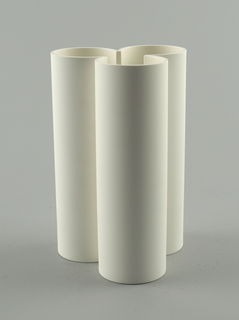 Tall white vase composed of a trefoil.