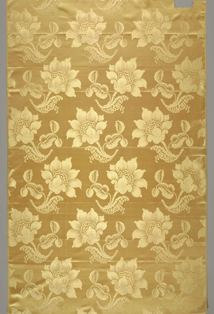 Tan satin with a staggered horizontal repeat of large-scale blossom, leaf and stem.
