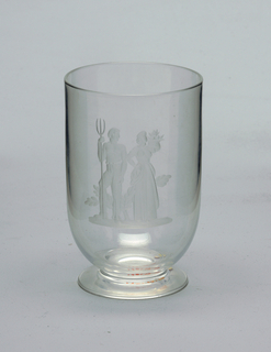 Footed with a farmer couple engraved on front