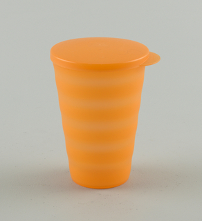 "Large, translucent ""Sunset Orange"" tumbler with frosted finsih, lid/seal, and horizontal wave design for no-slip grip."