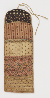 Folding oblong needle case made of seven different printed cottons; four pockets, one with a piece of wool for needles. In one pocket a small semicircle of newspaper dated 1838.