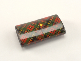 "Oblong, with long sides curved, covered in a tartan pattern printed paper in red, green, black, and yellow, as well as possible maker's mark and pattern name ""Prince Charlie"" printed in gold on front. Slip top style lid meets box body at center. Small match socket in ivory on lid top. Striker of sandpaper on bottom."
