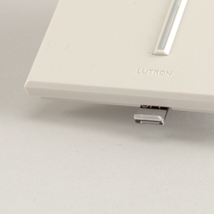 Flat white rectangular plastic form with vertical clear LED strip in center.