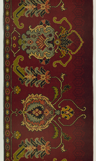 Floral rug design showing Persian influence in bold colors on a dark red ground. Wide plain weave selvage on left side.