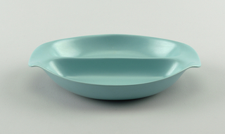 Blue-green two-sided bowl, with two oval indentations to separate food and curved handles.