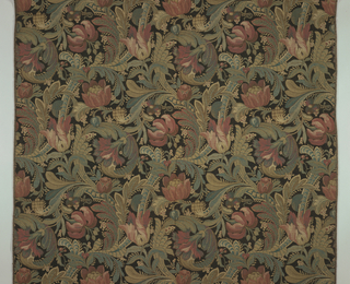 a) Length of upholstery fabric with an exotic floral vine muted red, blue, green and ochre on black background. The pattern is achieved by brick repeat of the rectangular pattern. b) Same pattern with deep purple, blue-green, dark green, yellow and ochre floral vines and tan background.
