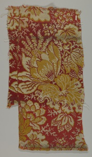 Large-scale floral design in red, yellow and ivory.