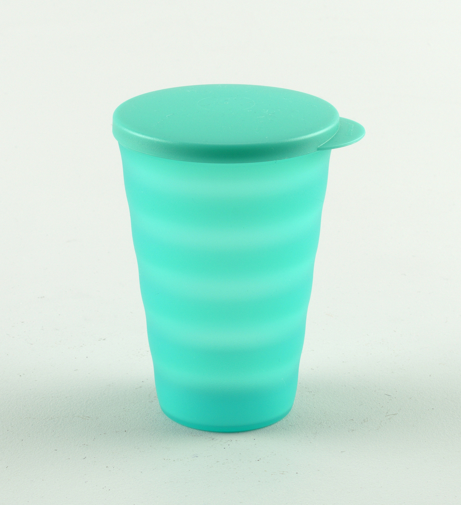 "Large, translucent ""Island Green"" tumbler with frosted finsih, lid/seal, and horizontal wave design for no-slip grip."