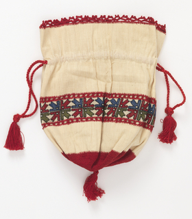 Drawstring bag of white cotton with a band of embroidery across the center with a pattern of stylized plant forms in red and green. Open band of buttonholing on top and bottom edge of the band. Top and bottom of bag trimmed using crochet. Draw cord of red silk with tassels.