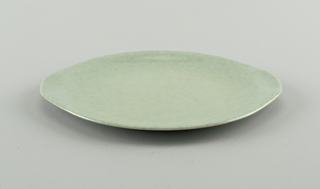 Gray-green plastic plate with extended sides to serve as handles.