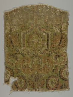 Fragment of a formal pattern with brackets and floral forms in dark orange, brownish-black and ivory on a pale green background. The entire surface is cut pile of wool with some linen.