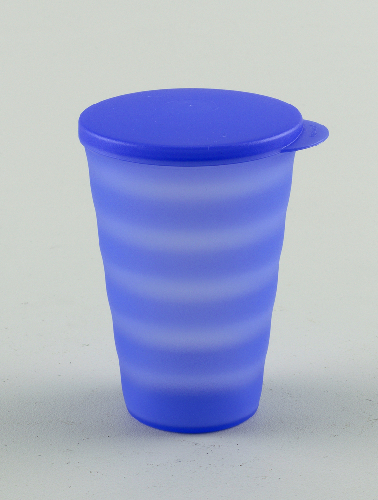 "Large, translucent Ocean Blue"" tumbler with frosted finish, lid/seal, and horizontal wave design for no-slip grip."