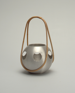 Spherical aluminum body, with circular cut-outs, long wooden loop handle.