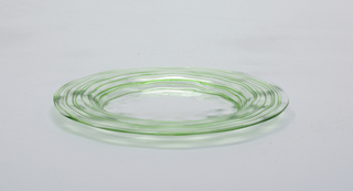 Circular, clear glass with light green threading applied to underside of rim.