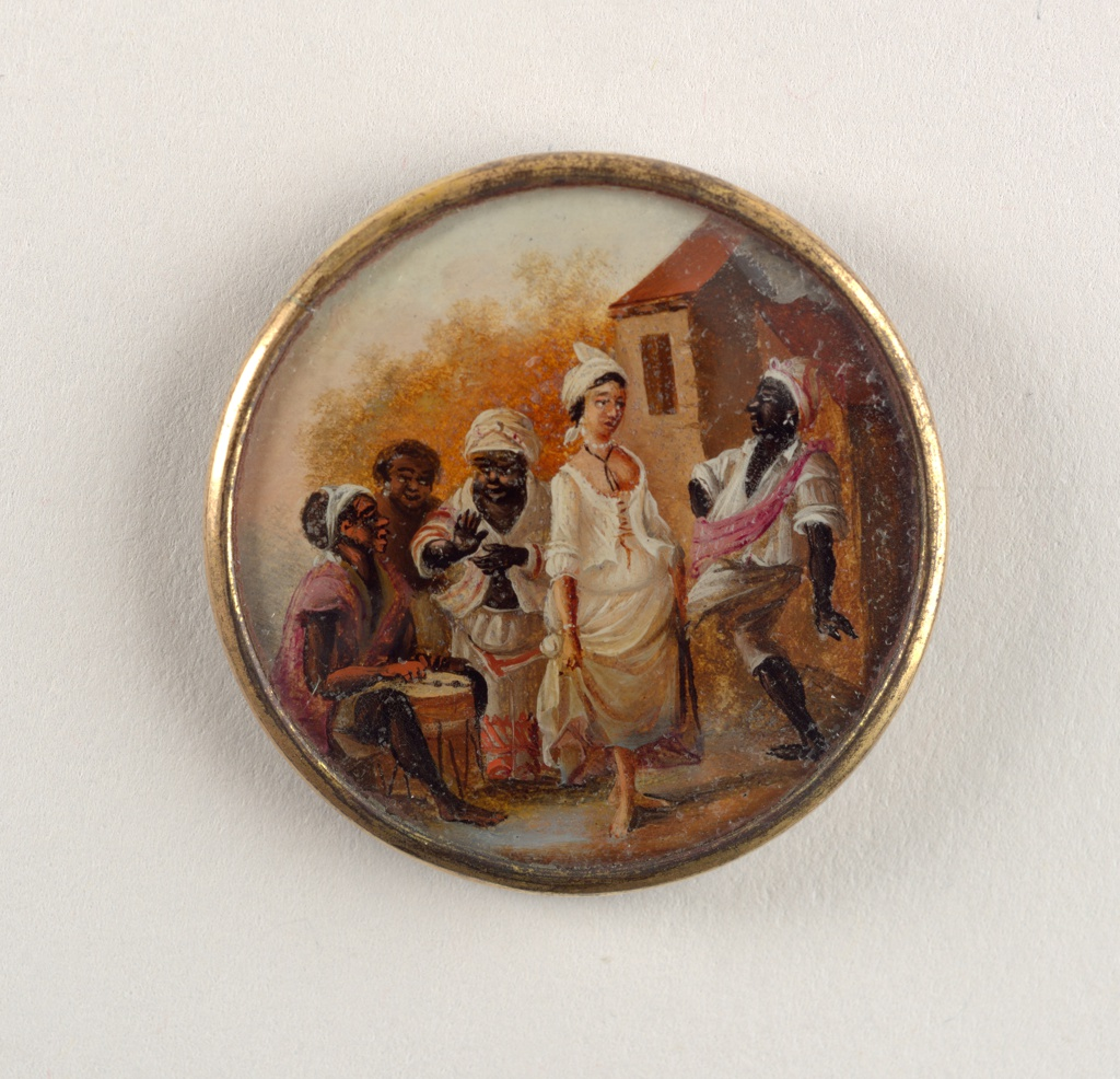 Button depicting scene of five figures outside near a large house. From left: a seated man, wearing a pink shirt, playing a drum, a woman with only head visible standing behind another woman, wear white with pink stripes, who claps [to the music]. In the foreground, a lighter skinned woman wearing an open corset and skirt dances with a man who wears white clothing and a pink sash.