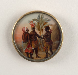 Button depicting scene with three figures in a palm tree-filled landscape conversing. Two men wear native West Indies garments of skirts; one wears a red feathered crown; the other holds a bow and carries a quiver of arrows on his back. Woman on the left wears a Western skirt with no shirt and a red scarf on head; her back is towards the viewer and she carries a basket of flowers.