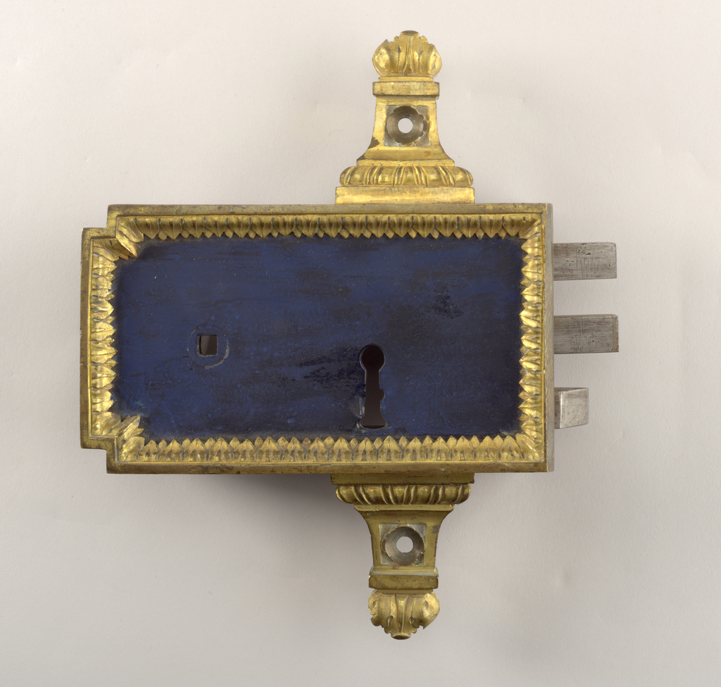 Case of steel, with border of fire-gilt bronze on face, and bronze arms top and bottom.