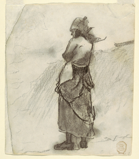 Horizontal view of the back of a standing woman, dressed in the clothes of a fishwife, looking out to sea; parts of two boats are seen in the right background.