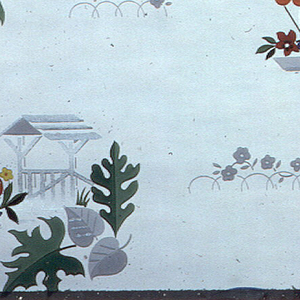 Evenly spaced motifs of window boxes, umbrellas, small tables and an arbor, each with a grouping of green and grey leaves. Grey flowers are spaced throughout. Blue, yellow, orange, red grey and metallic silver are used in each motif on a white ground.