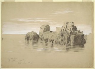 Group of tall rocks off coast, lower half of rocks covered with lichens or moss, upper half bare rock.